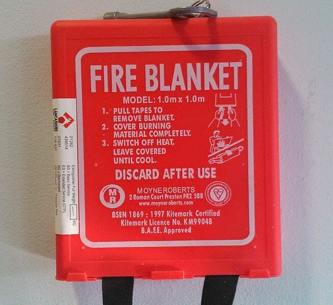 Fire Safety Blanket, By 247homerescue (Own work) [CC0], via Wikimedia Commons