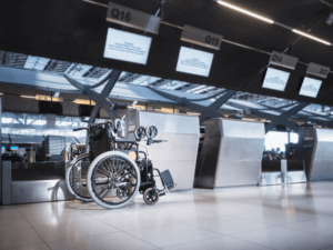 Wheelchair by check in desk at the airport. Why you should book special assistance when travelling with a disability